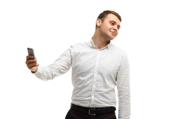 Businessman makes selfie using phone