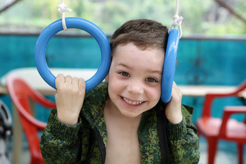 Child on gymnastic rings