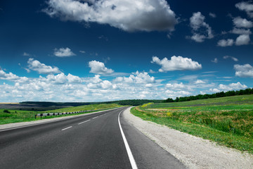 Wall Mural - Empty asphalt road at daytime. Beautiful nature landscape