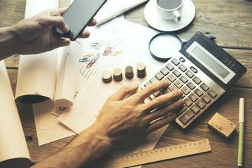 man hand calculator