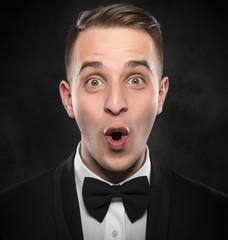 Portrait of surprised man.