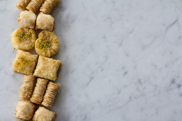 Row of Baklava on Marble Background From Above with Copy Space
