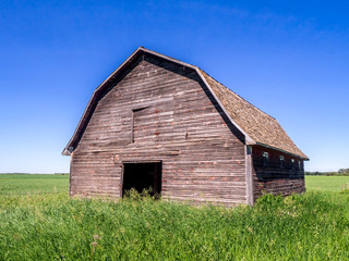 Old barn on the prairies in Saskatchewan on a summer day.