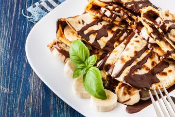 Crepes with banana and chocolate cream