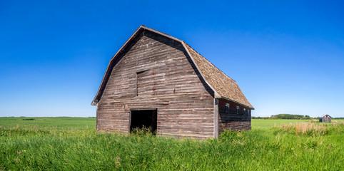 Old barn on the prairies in Saskatchewan on a summer day.