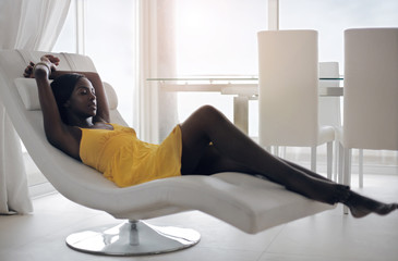 Model lying on a chaise longue