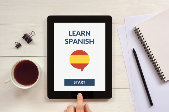Online learn spanish concept on tablet screen with office objects. All screen content is designed by me