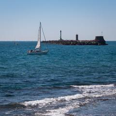 White Sail Ship near Seashore