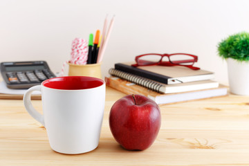 White mug with red apple