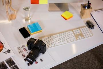Camera by keyboard at desk