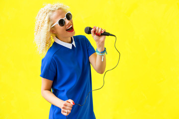 Woman singing and using microphone