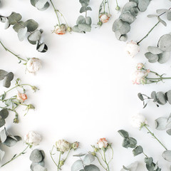 wreath frame with roses, eucalyptus branches, leaves and petals isolated on white background. flat lay, overhead view