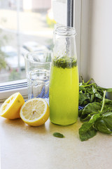Summer drink with lemon, basil and soda