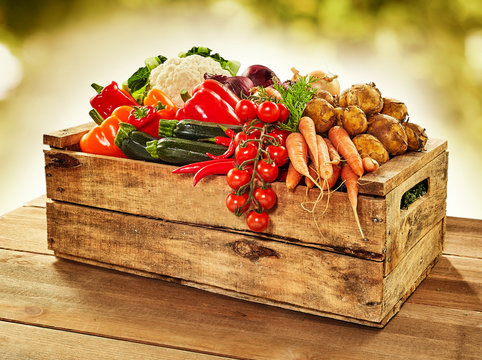 Wooden crate filled with farm fresh vegetables