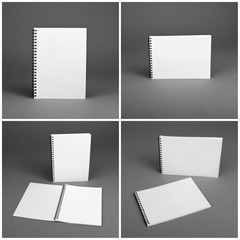 Set of blank spiral notebooks on gray background