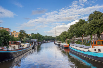 Canal with ships in the center of Groningen
