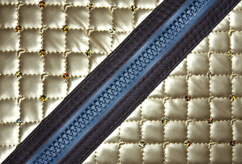 golden leather texture with diagonal zipper