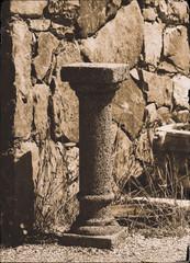 Vertical antique pedestal bokeh design postcard composition