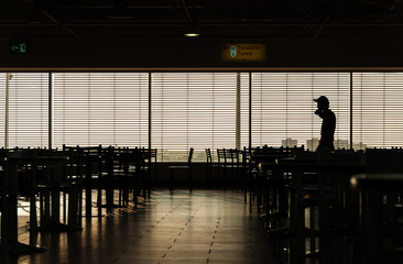 Airport cafe man silhouette