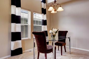 Open floor plan dining room with carpet floor