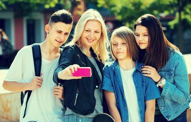 Teenagers doing selfie outdoors
