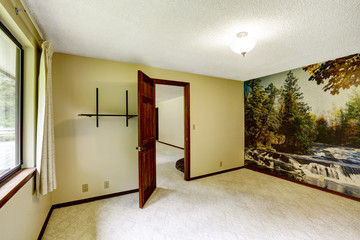 Empty room with carpet floor and wallpaper on the wall