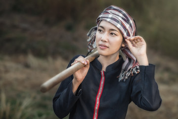Portrait of Asian country girl working on field.