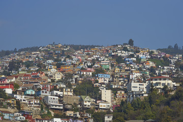 Colourfully decorated houses crowd the hillsides of the historic port city of Valparaiso in Chile.