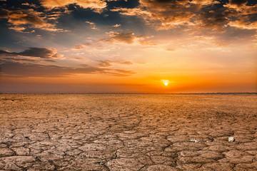 Cracked earth soil sunset landscape