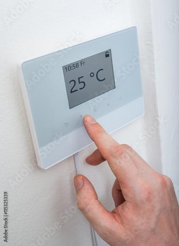 Heating Concept Man Is Adjusting Temperature In Room On
