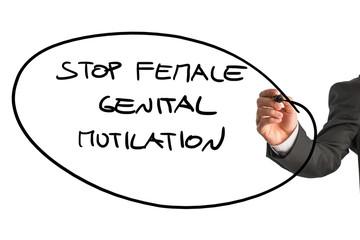 Man writing a sign Stop Female Genital Mutilation
