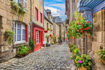Idyllic scene of traditional houses in narrow alley in an old town in Europe Fototapete