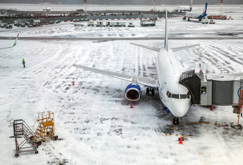 Passenger Airplane on airfield winter
