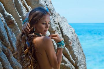 Amazon girl. Attractive young woman in bikini outdoors