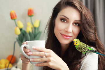 woman with green parrot