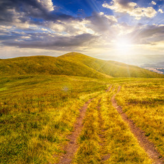 path through mountain landscape at sunset
