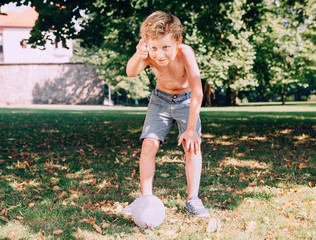 Boy want to kick the ball