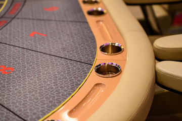 Part of  poker table with cupholders