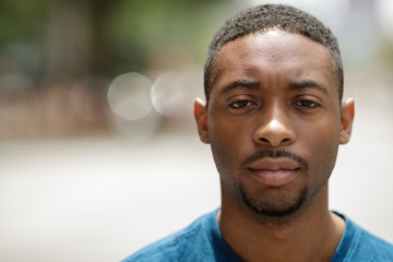 Young black man in city serious angry face portrait