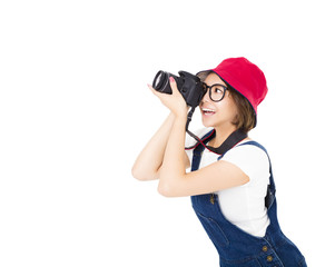 happy young woman taking photo on camera