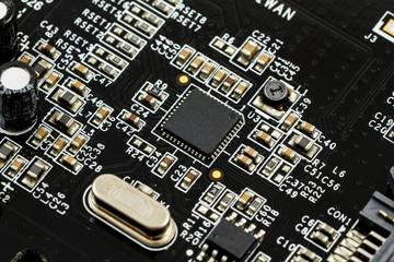 Printed Circuit Board (PCB) with, ICs, Capacitors, and Resistors
