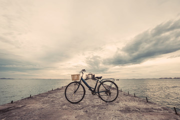 Vintage bicycle on concrete pier, vintage tone, soft focus