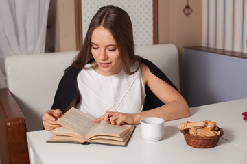 Woman with book and tea