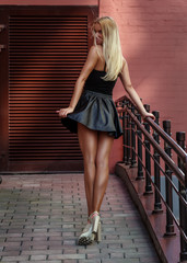 Beautiful blonde in a short black skirt