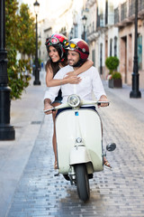 Cheerful Couple Riding a Vintage Scooter