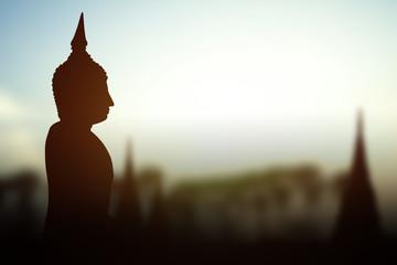 Silhouette of Buddha.Background sunrise