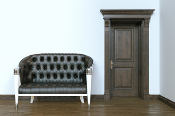 Classic leather sofa in modern interior with wooden door.
