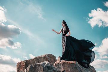 dark evil queen sneaks through the stone canyon, wild Princess , vampire , hip toning , creative color,dark boho