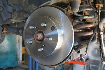 close up on wheel hub and disk brake, car repair
