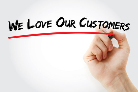 Hand writing We Love Our Customers with marker, concept background